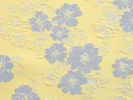 Broché jaune à fleurs bleu