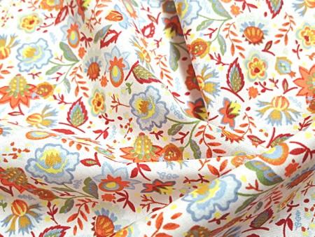 Popeline de coton imprimé fleuri orange