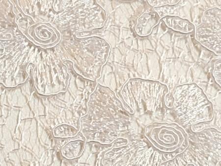 Guipure de fleurs blanches